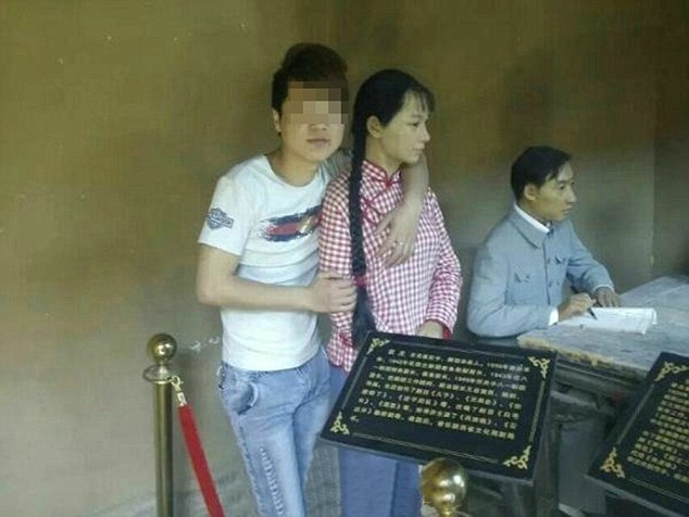 Pic shows: Male tourist kissing a wax figure at a revolutionary memorial site. A male tourist has been slated by Chinese media after he was seen kissing and fondling a wax figure at a famous memorial site. The unidentified man was travelling with a tour group to the Malan revolutionary memorial in Xunyi County of north-west China's Shaanxi Province, where the Chinese Revolution has been enshrined in the form of several wax displays. Netizens were angered by the young man, who stepped into the display area with the wax figures even though it was off limits, and was then seen hugging and kissing a figure of a woman whose breasts he also fondled. The man had his photographs taken while fondling the wax figure, which caused anger amongst netizens who have been calling for his arrest, and for authorities stamp to do more to stamp out uncivilised behaviour by tourists. Another young man was blacklisted from scenic areas in China after he took a photo of himself sitting on top of a Red Army statue. Now netizens are hoping for similarly harsh punishment for the wax breast fondling tourist. Several days ago the China National Tourism Administration released its blacklist for misbehaving tourists in a bid to curb inappropriate behaviour by naming and shaming those banned from visiting touristic treasures. (ends)