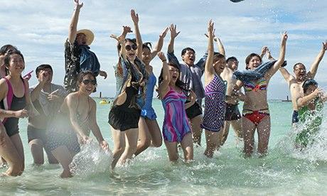 Chinese tourists jumping